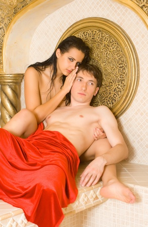 a young woman and young boy in a Turkish bath photo