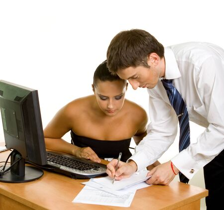 Two contemporary businesspeople discussing a document Stock Photo