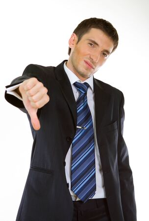 Businessman showing thumbs down gesture with white background photo