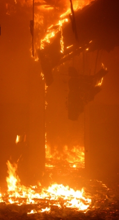 Fire in Building, doorway enveloped in flames during a fire
