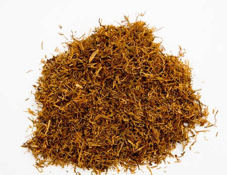 Loose shredded tobacco isolated on white background with copyspace