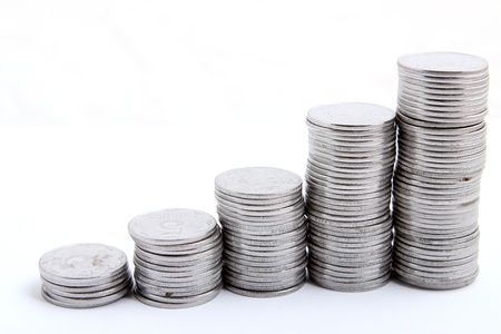 stack of coins isolated on a white background Standard-Bild