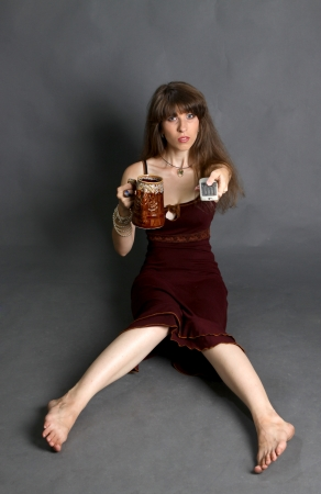 Girl with the panel from the TV and a glass of beer photo