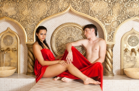 young woman and young boy in a Turkish bath photo