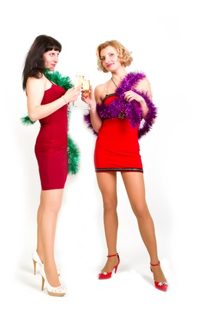 Two laughing women at party celebrating with champagne photo