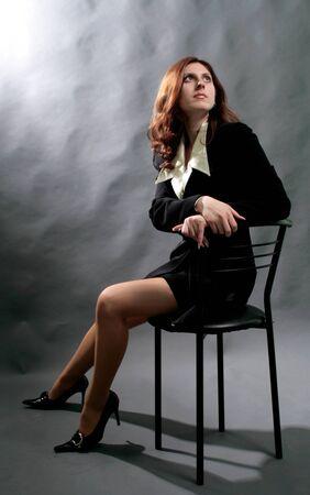 elegant fashionable woman on grey background