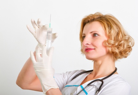 nurse gloves: medical doctor with syringe Stock Photo
