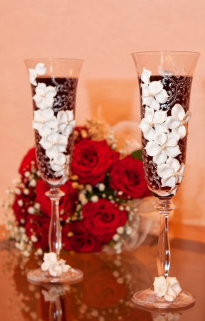 Bride bouquet with glass of champagne photo