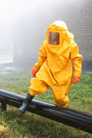man in yellow chemical suit  for cleaning operation