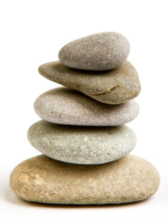 Stack of white stones balancing isolated on white