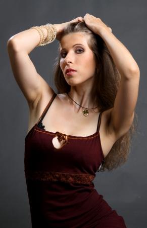 velvet dress: The beautiful girl in a red velvet dress with wavy hair.