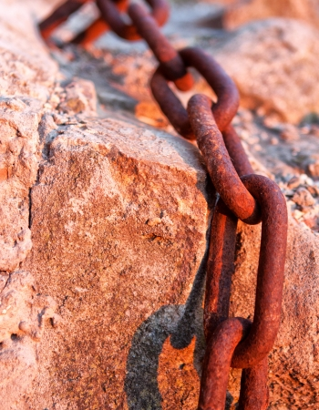 Macro chain link, rusted steel. Marine environment Stock Photo - 17034910