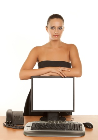 Isolated young business woman holding  a computer monitor   photo