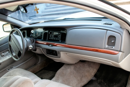 car dashboard gray with wood inlay photo