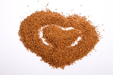 mingle: Instant coffee in the form of heart on a white background Stock Photo