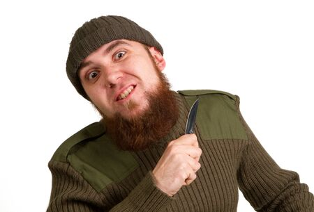 A young bearded man with a knife on a white background photo
