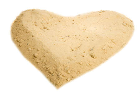 Shape of heart into a sand Isolated on white background photo