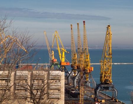 Cargo crane, ship and grain dryer in port Odessa, Ukraine Stock Photo - 17687930