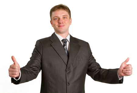 Happy businessman showing his thumbs up with smile over white background photo