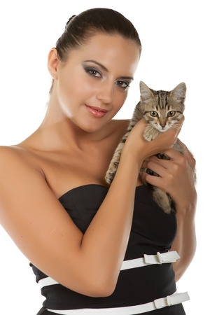 Young pretty woman hold her lovely  cat  isolated on a white background photo