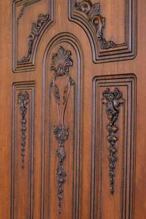 fragment beautiful carved brown wooden door with an emphasis on design Stock Photo - 18161711