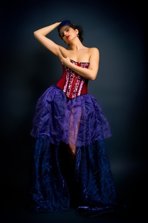 red corset: Sexy young woman in fashion dress, girl in a red corset on a dark background Stock Photo