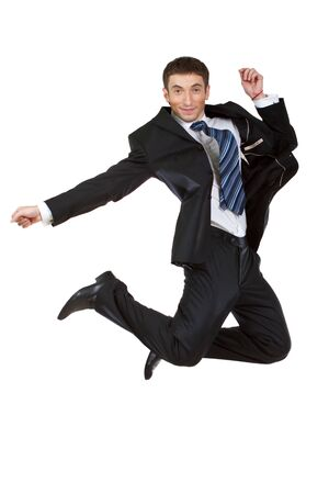 Young happy caucasian businessman jumping in the air , isolated on white background photo