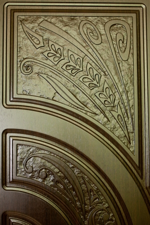fragment beautiful carved brown wooden door with an emphasis on design Stock Photo - 18443060