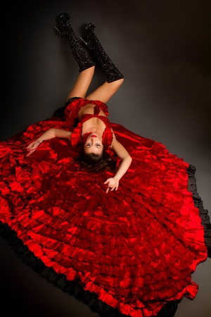 Close-up photo of the lady in gypsy costume dancing flamenco  on a gray background photo