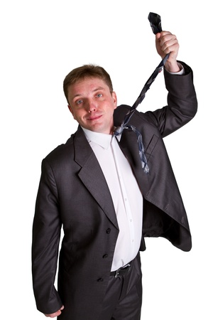Caucasian mid-adult man pulling necktie out to choke himself while making facial expression. photo