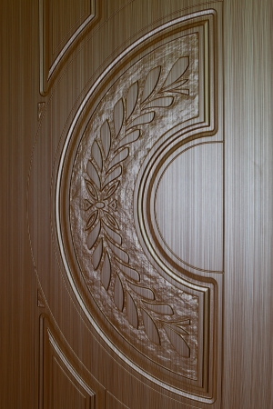 fragment beautiful carved brown wooden door with an emphasis on design Stock Photo - 18502366