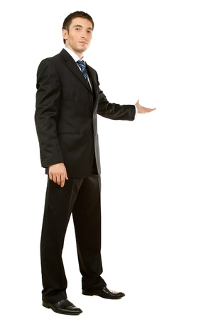 Businessman with arm out in a welcoming gesture , isolated on white background photo