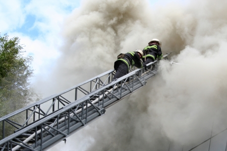 fireman wearing a gas mask on the stairs Stock Photo