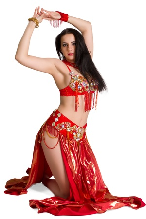 bellydancing: Beautiful young girl in a red suit oriental dance in motion isolated on white background