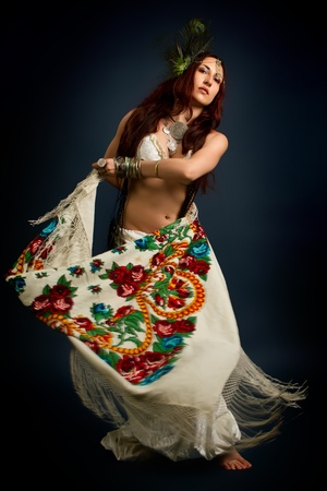 ancient sexy: Performance. Young attractive retro model in old-fashioned wild clothing dancing. Tribe. Tattoo. Native savage woman Stock Photo