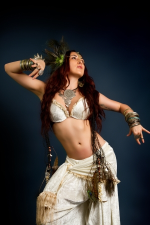 Young attractive retro model in old-fashioned wild clothing dancing Standard-Bild