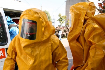 man in  chemical suit  for cleaning operation Editorial