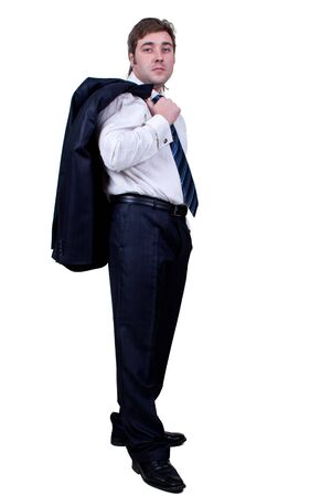 Happy young businessman with jacket on shoulder and hand in pocket posing and smiling  isolated in white