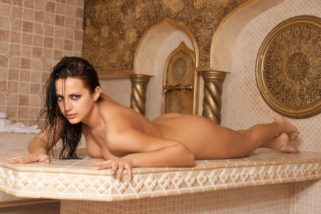 Young naked woman enjoying hamam or turkish bath Stock Photo