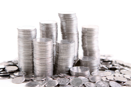 numismatics: stack of coins isolated on a white background Stock Photo