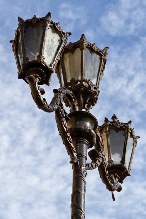streetlamp: Old Fashioned Street Light against a Blue Sky Stock Photo