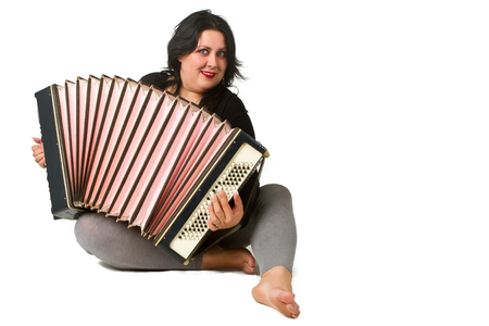 beautiful young brunette with accordion photo