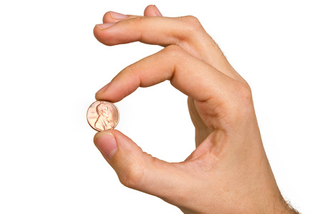 man's hand holding coin isolated on white background