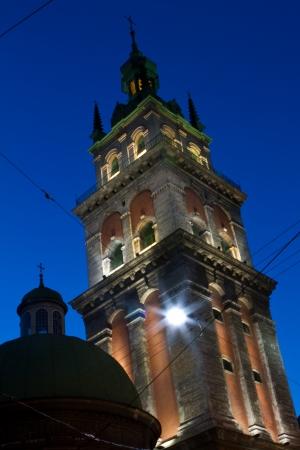 Illuminated City Hall on Lviv Market Square at twilight photo