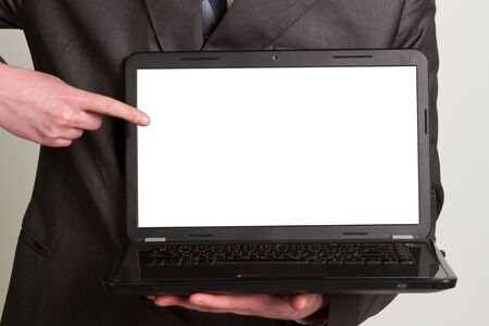 Office worker holding blank computer monitor with clipping path for the screen photo