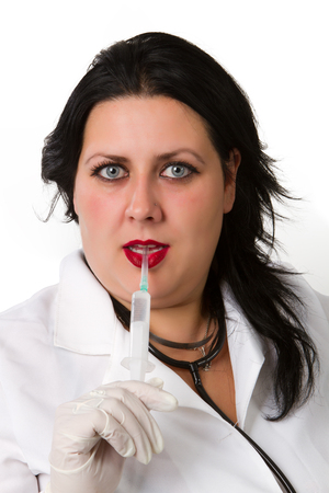 Full isolated studio picture from a young and beautiful doctor  in gloves showing ampule photo