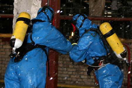 man in  chemical suit  for cleaning operation photo