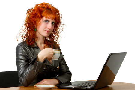 A young woman holding a cup of coffee at her workplace on a white background photo