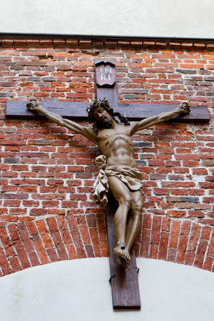 crucifix on the front of the Armenian Cathedral in Lviv photo