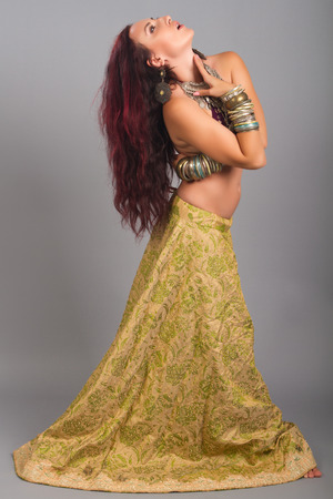 kuchipudi: Beautiful girl belly dance movement, Young beautiful belly dancer in a  golden costume Stock Photo